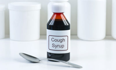 Cough syrup bottle and spoon