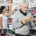 man and woman shopping in pharmacy