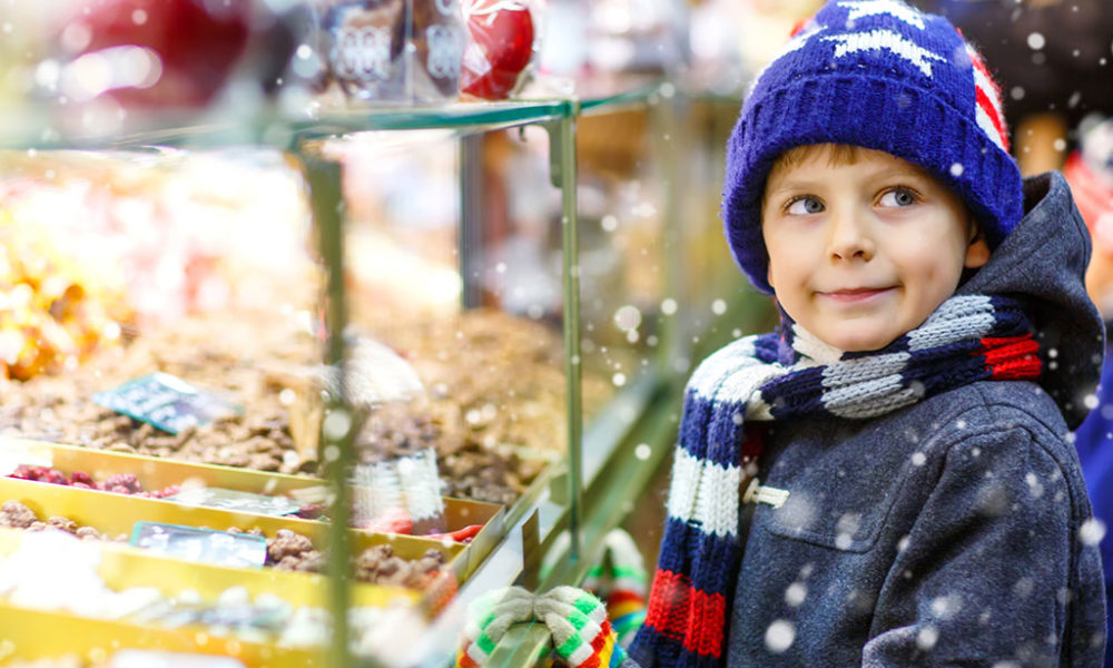 boy looking at candy case
