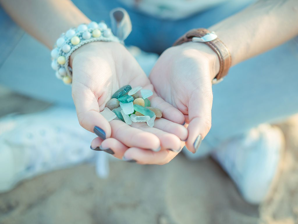 Girl holding sea glass