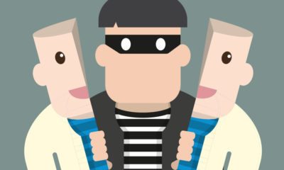 Cartoon of man with burglar inside