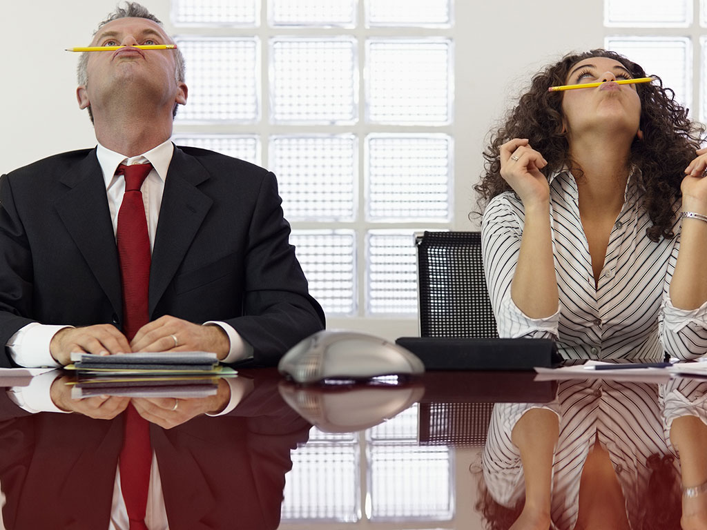 Woman and man bored office
