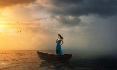 Woman facing hurricane