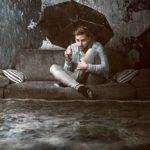 Man in rain umbrella