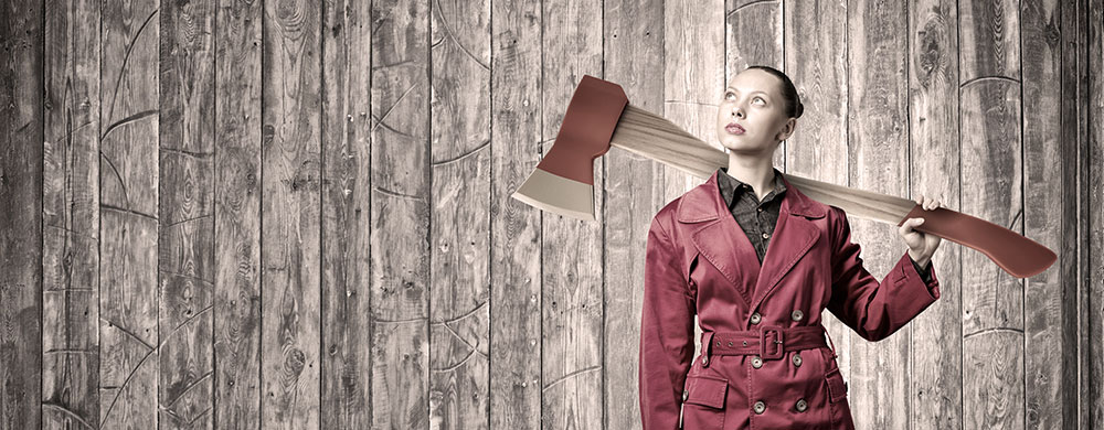 Woman detaches with an ax