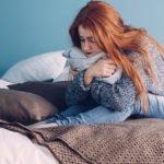 Girl in bed in pain