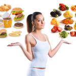 Woman with healthy and unhealthy foods
