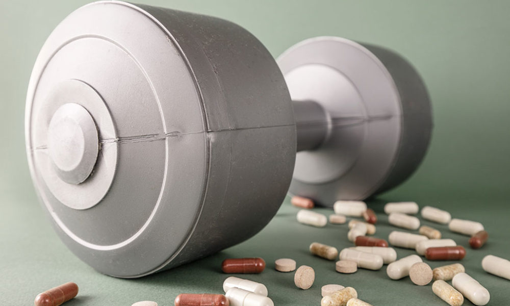 Barbell and pills