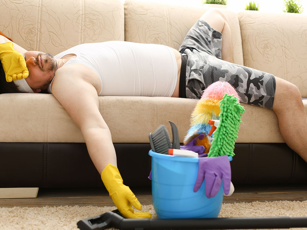 Man exhausted on couch