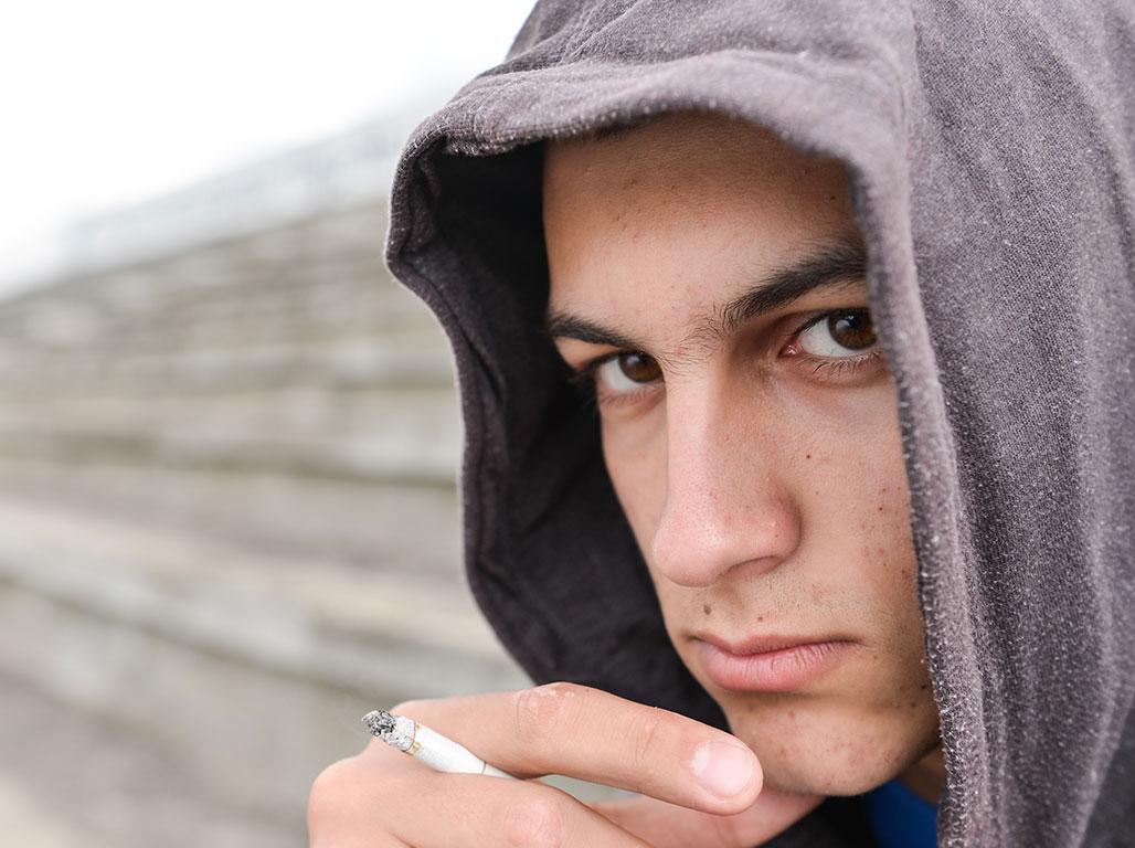 Teen with marijuana cigarette