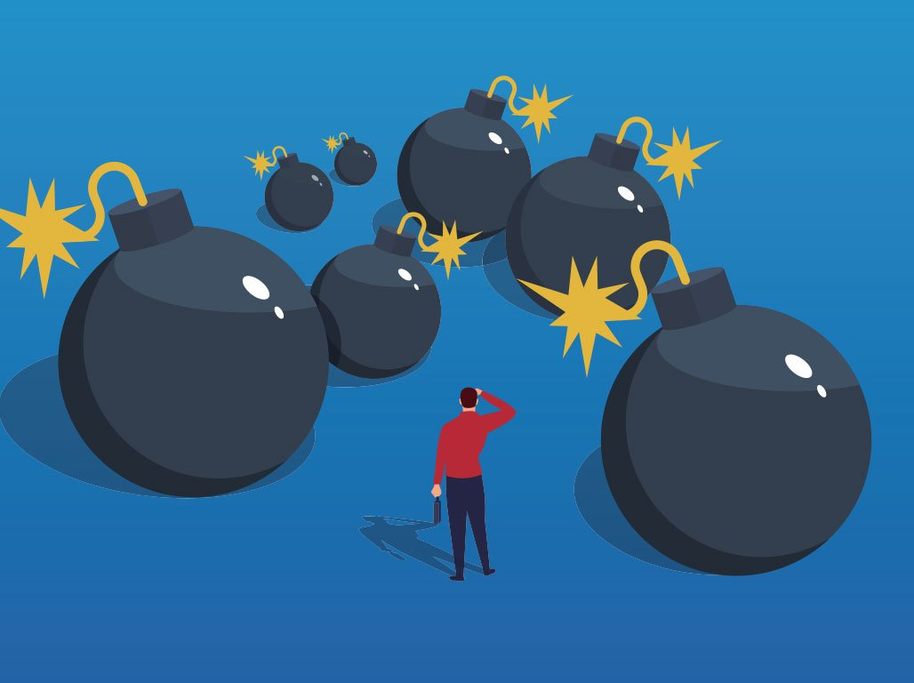 cartoon of man surrounded by lit bombs