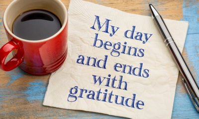 cup of coffee and napkin My day begins and ends with gratitude