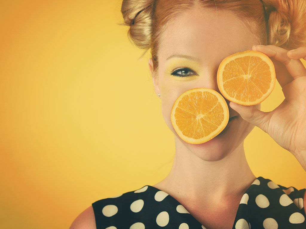 Girl holding orange slices