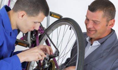 Men fixing bike