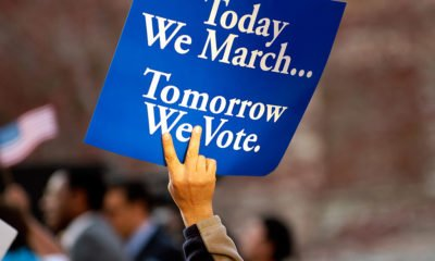Today we march tomorrow we vote