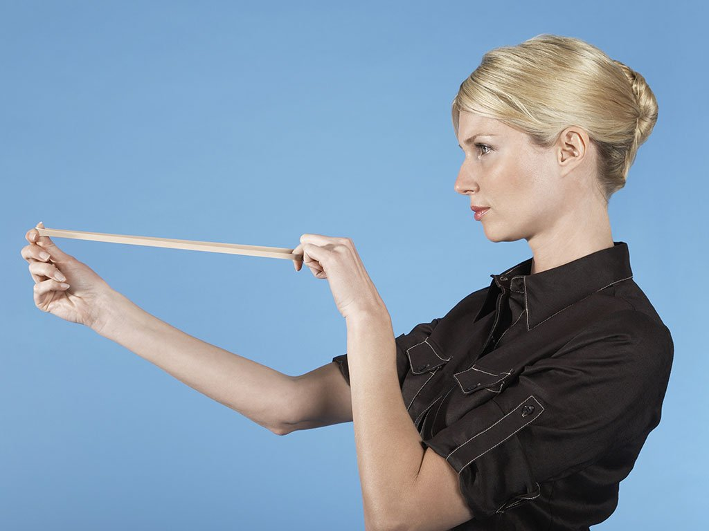 Woman snapping rubber band