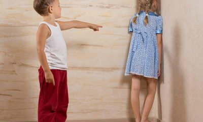 boy putting girl in the corner