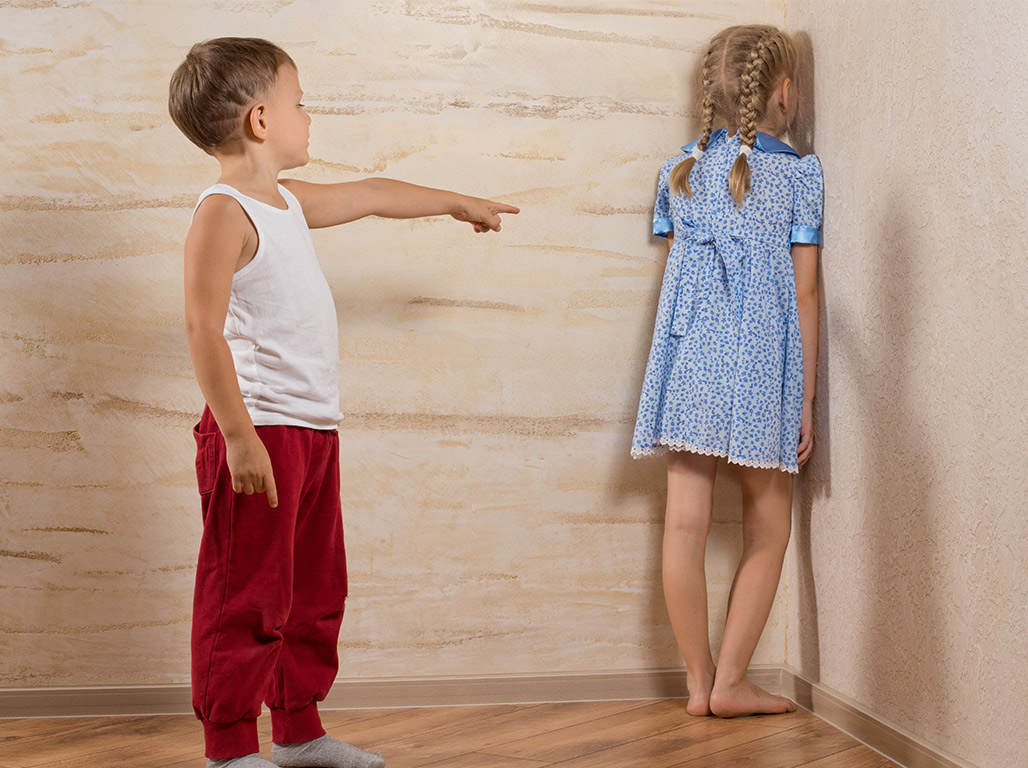 boy putting girl in the corner