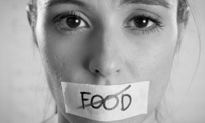 woman with tape over her mouth with food