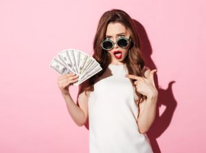 Trendy woman with cash