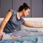 Girl doing yoga in bed