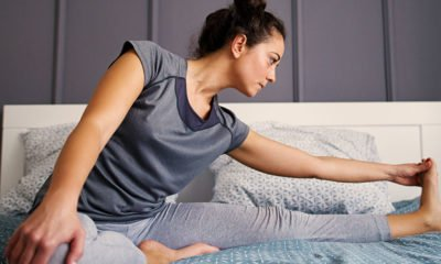 Girl exercising in bed