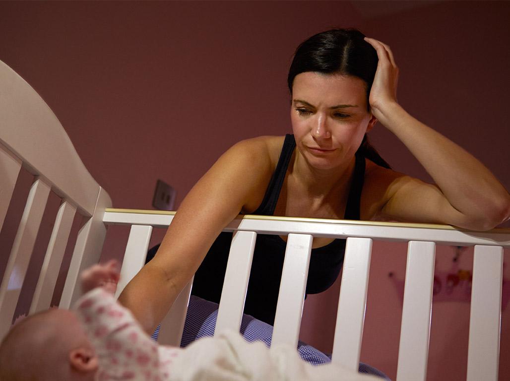mother conforting newborn