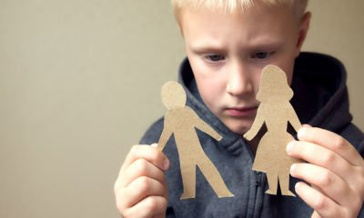 boy choosing between cut out mom and dad