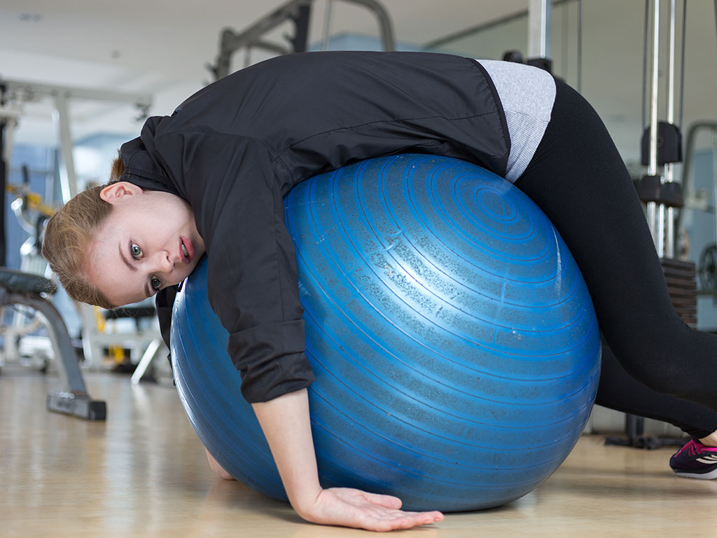 Exhausted girl exercising