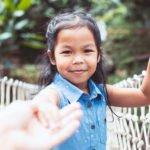 Little girl crossing bridge