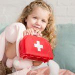 Girl with recovery first aid kit
